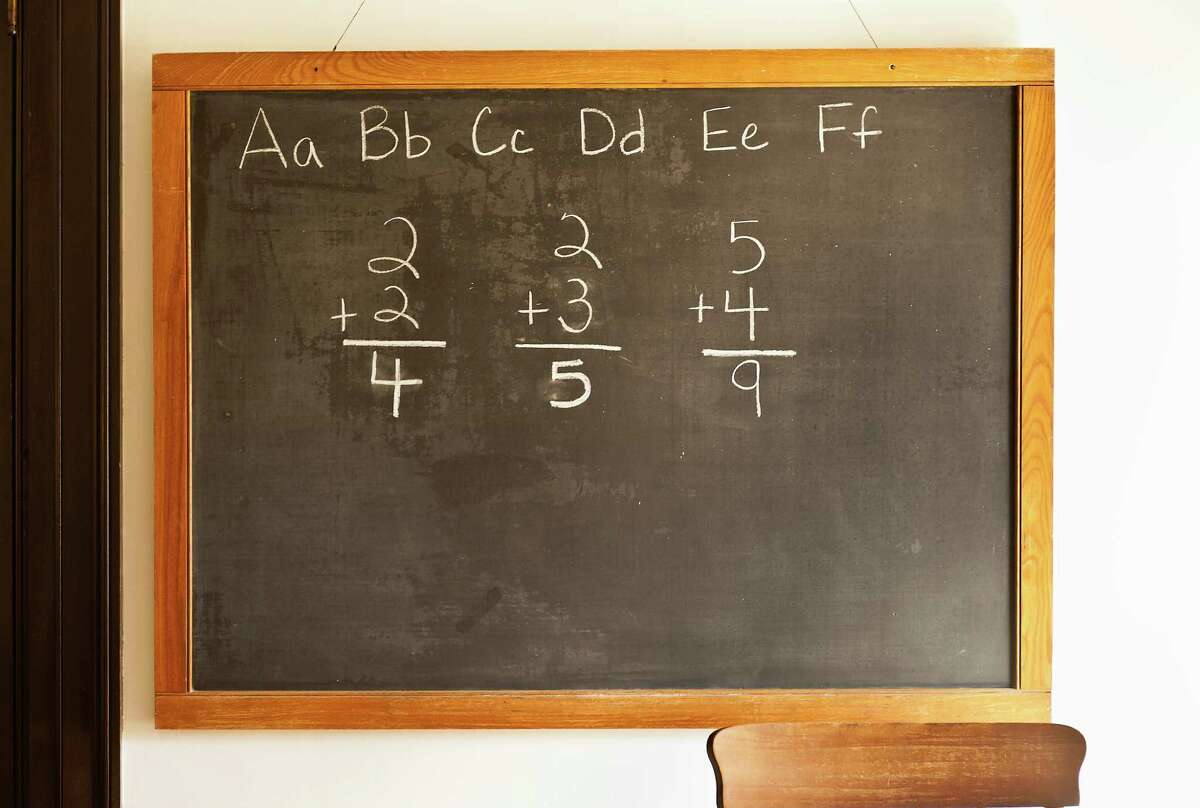A file photo shows a chalk board in an American classroom.