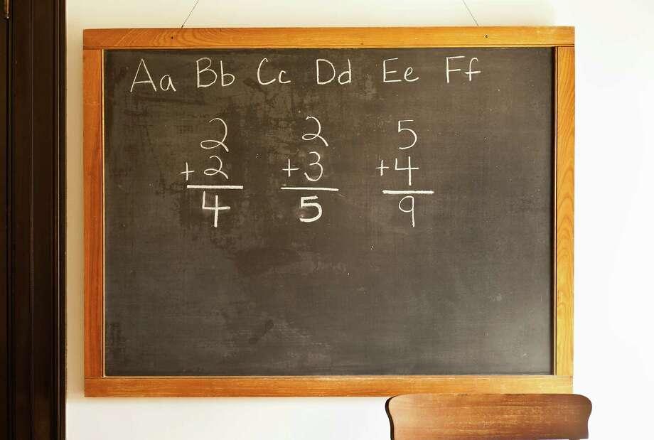 A file photo shows a chalk board in an American classroom. Photo: John Greim, Getty Images / © 2010 John Greim