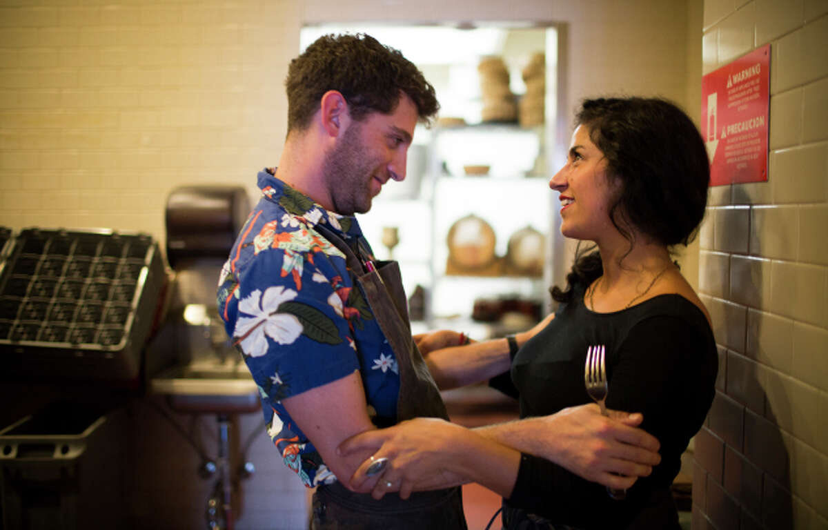 Camino line cook Danny Keiser visits with DeStefano before the restaurant opens.