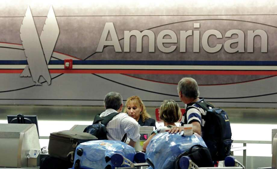 In this photo taken Tuesday, May 27, 2014, passengers check in at the American Airlines counter at Miami International Airport in Miami. American Airlines reports quarterly financial results on Thursday, Oct. 23, 2014. (AP Photo/Alan Diaz) ORG XMIT: NYBZ195 Photo: Alan Diaz / AP