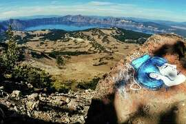 This undated photo taken from an Instagram posting shows an overlook of Crater Lake in Oregon. The National Park Service is investigating paintings of faces found on rocks across the West in some of the country's most recognizable wilderness areas. (AP Photo/Instagram)