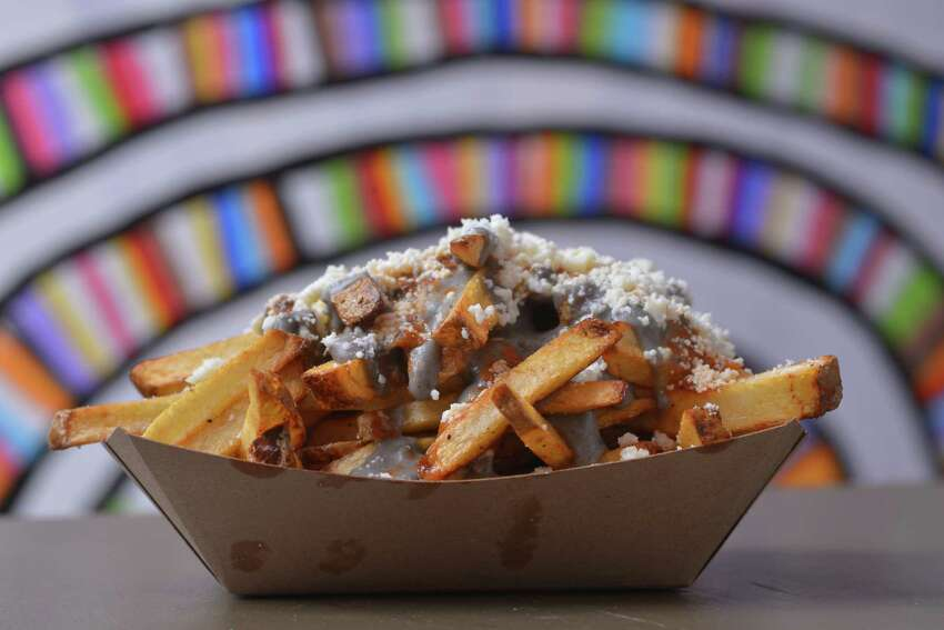 Taps y Tapas Huitlacoche, the corn fungus that's a delicacy in Mexico, adds an earthy flavor to house-cut potatoes in the Huitlacoche fries. A drizzle of chile de arbol salsa adds a touch of heat and a deeper flavor.