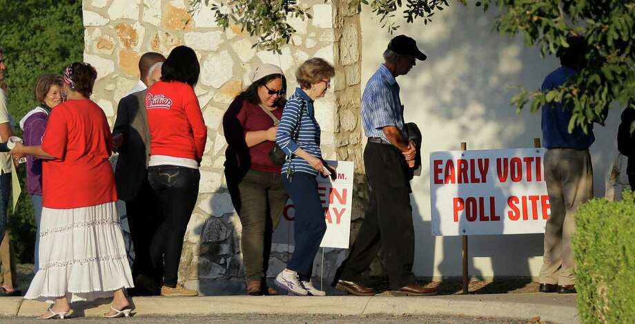 It's simply false that the voter ID law in Texas hasn't prevemted some otherwise eligible Texans from voting. Voters stand in line to vote at an early voting polling site on Oct. 20. Photo: Eric Gay /Associated Press / AP
