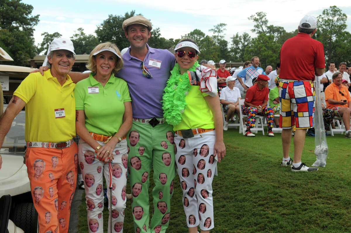 Bob Dernick, from left, Chris Dernick, Jason Alexander, and Shawna Alexander team up before the start of the tournament at The Clubs of Kingwood on Thursday. The Bad Pants Open, the original