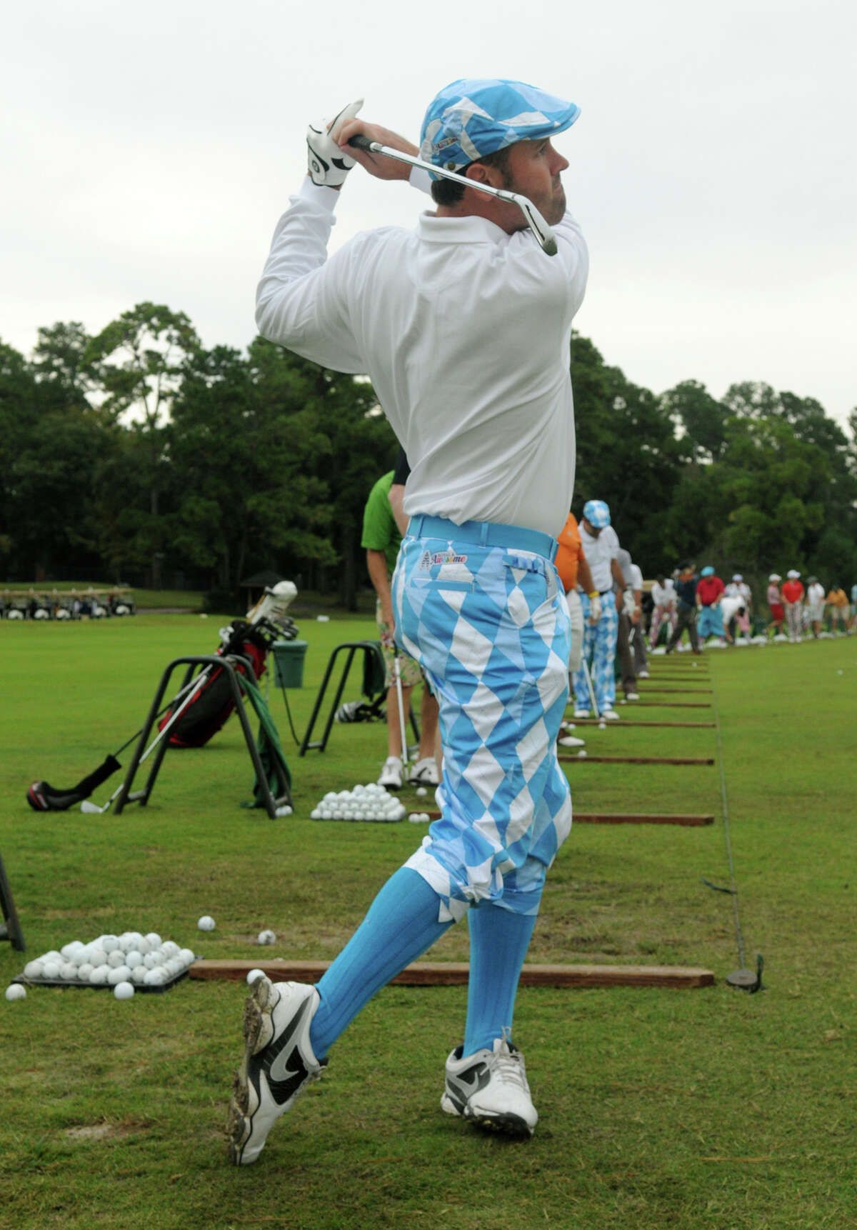 Sam Tucker, of Houston, loosens up on the driving range.