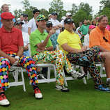 Arthur Fischetti, from left, of Pearland, Don Cohen, of Bellaire, Greg Gerner, of The Woodlands, and Don Nelson, of Houston, watch from the front row during Dan Boever's long-drive demonstration as part of the 17th annual Bad Pants Open Golf Tournament at The Clubs of Kingwood on Thursday.