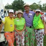 """Bob Dernick, from left, Chris Dernick, Jason Alexander, and Shawna Alexander team-up before the start of the 17th annual Bad Pants Open Golf Tournament at The Clubs of Kingwood on Thursday. The Bad Pants Open, the original """"bad pants"""" golf tournament that has spawned copy-cat tournaments throughout the country, has raised over $3.2 million to-date for leading research, treatment and care of critically ill and premature infants at Texas Children's Newborn Center."""