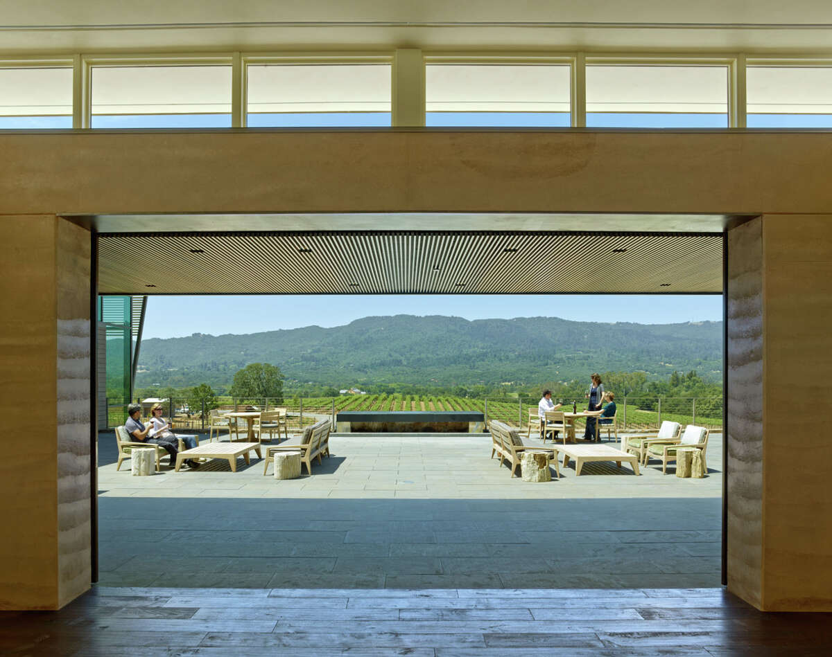 The furnished, opulent hillside terrace patio at Hamel Family Wines overlooks Sonoma Valley vineyards.