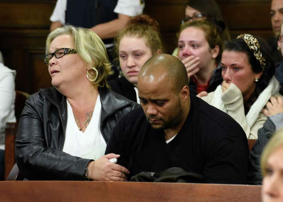 Shannon Williamson, left and Nate Milligan show the anguish of seeing Gabriel Vega as he is arraigned on numerous charges including murder in connection with the death of Vanessa Milligan. He appeared in Rensselaer County Court on Thursday morning, Oct. 23, 2014 in Troy. Williamson is Vanessa Milligan's aunt and Nate Milligan is her father. (Skip Dickstein/Times Union) Photo: SKIP DICKSTEIN / 00029178A