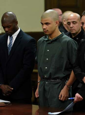 Gabriel Vega, center, is arraigned on numerous charges including murder in connection with the death of Vanessa Milligan. He appeared in Rensselaer County Court Thursday morning, Oct. 23, 2014, in Troy.  Vega is represented by attorney William Little, left.  (Skip Dickstein/Times Union) Photo: SKIP DICKSTEIN / 00029178A