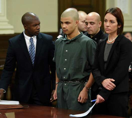 Gabriel Vega, center, is arraigned on numerous charges including murder in connection with the death of Vanessa Milligan. He appeared in Rensselaer County Court Thursday morning, Oct. 23, 2014, in Troy.  Vega is represented by attorneys William Little, left and Sara Beth Fedele, right.    (Skip Dickstein/Times Union) Photo: SKIP DICKSTEIN / 00029178A