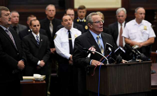 Troy Mayor Lou Rosamilia, left, is joined by a number of state and local law enforcement members in the courtroom after Gabriel Vega was arraigned on murder charges in connection with the killing of Vanessa Milligan.   (Skip Dickstein/Times Union) Photo: SKIP DICKSTEIN / 00029178A