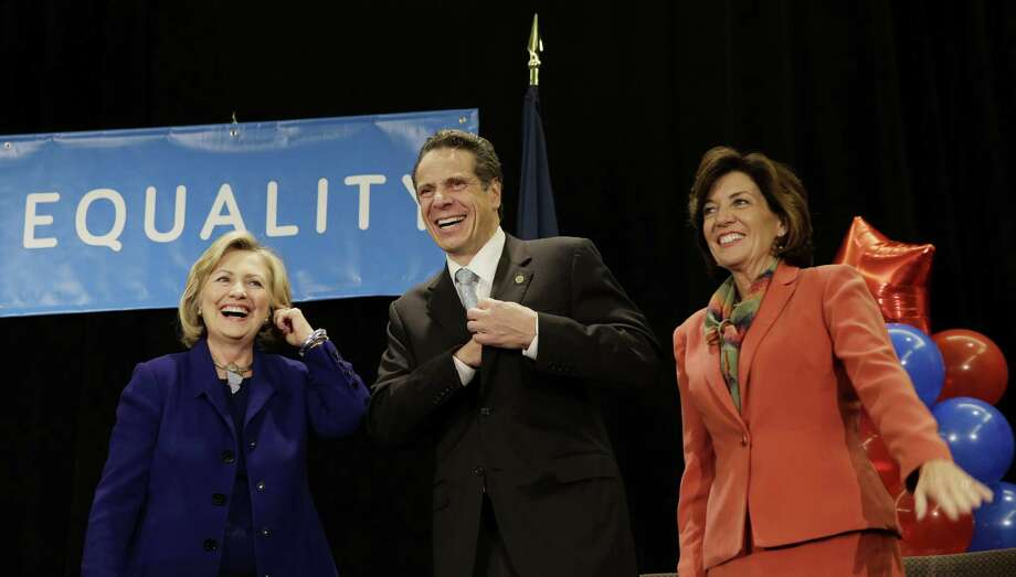 "Former Secretary of State Hillary Rodham Clinton, left, New York Governor Andrew Cuomo and Lt. Governor nominee Kathy Hochul laugh on stage during a ""Women for Cuomo"" campaign event in New York, Thursday, Oct. 23, 2014.  Mrs Clinton is backing Cuomo in his bid for a second term.  Cuomo faces Republican Westchester County Executive Rob Astorino in the Nov. 4 general election. (AP Photo/Seth Wenig) ORG XMIT: NYSW107 Photo: Seth Wenig / AP"