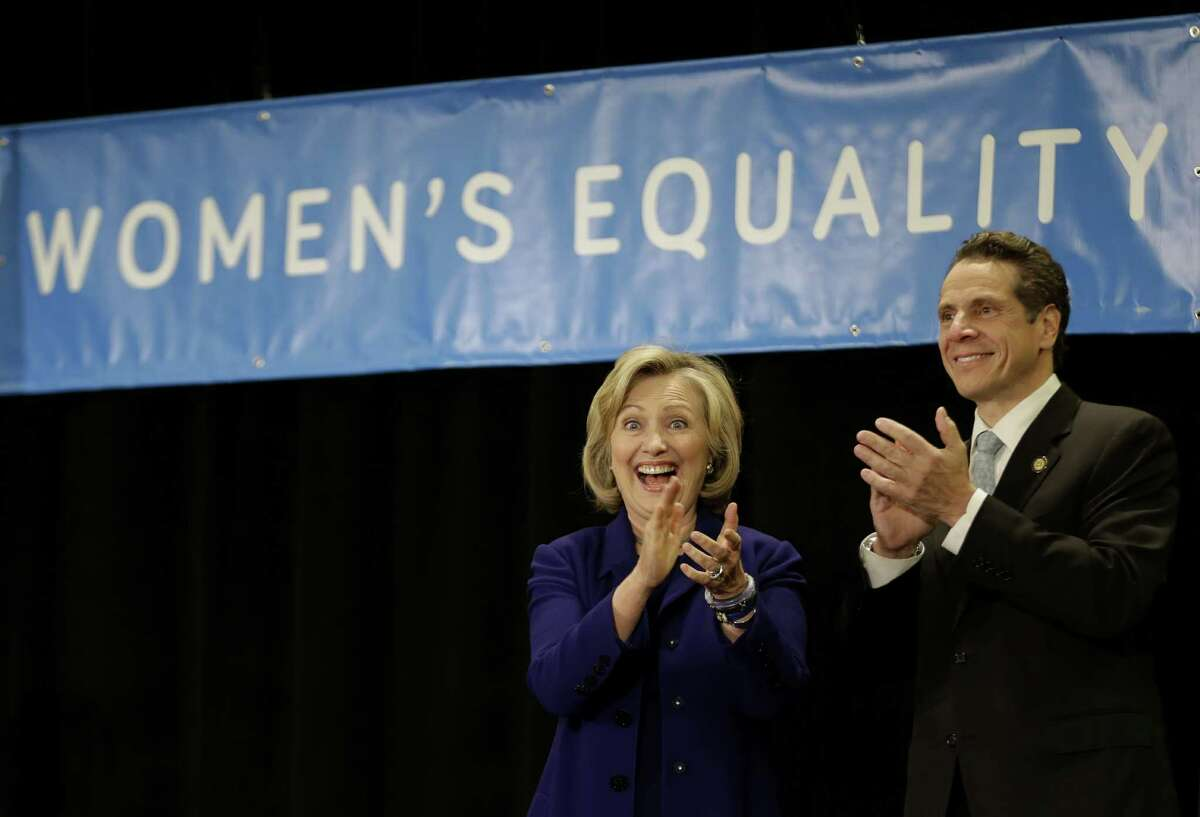 Former Secretary of State Hillary Rodham Clinton and New York Governor Andrew Cuomo greet supporters during a