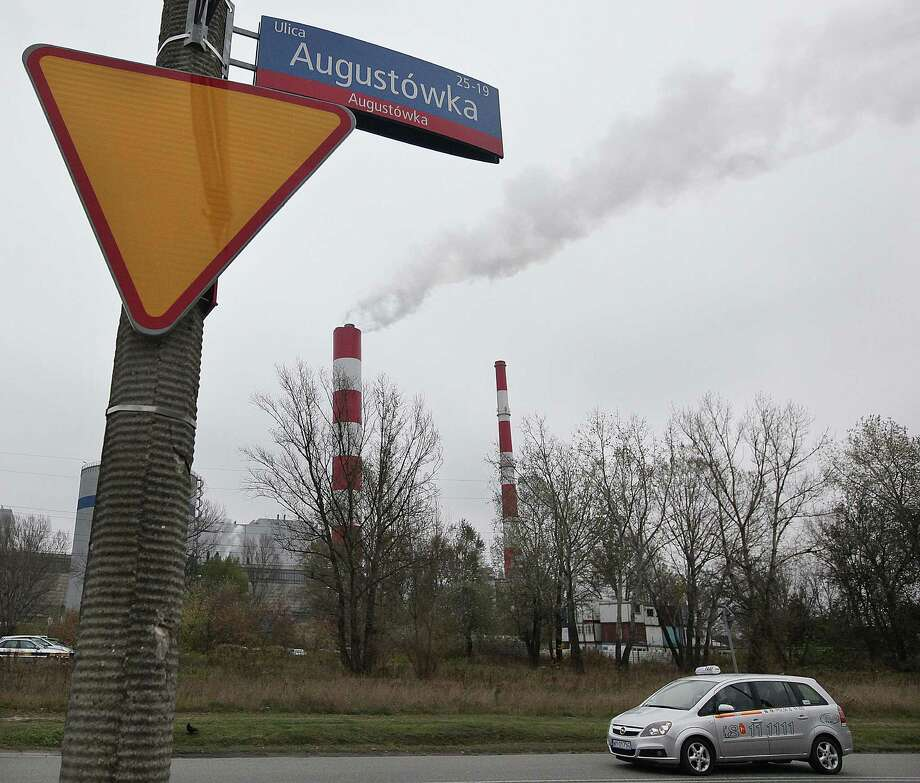 Smoke rises from a heat and power plant in Warsaw, Poland, Thursday, Oct. 23, 2014. European Union leaders meeting in Brussels to stamp their new, ambitious greenhouse gas emissions plan should prepare for unyielding opposition from coal-reliant Poland and some other East European countries who say their developing economies and electricity bills would suffer too much from the new target. (AP Photo/Czarek Sokolowski) ORG XMIT: XCS160 Photo: Czarek Sokolowski / AP