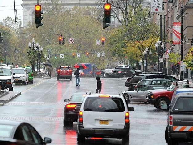 Pedestrians cross State St. on a rainy day Thursday, Oct. 23, 2014 in Albany, N.Y.  (Lori Van Buren / Times Union) Photo: Lori Van Buren