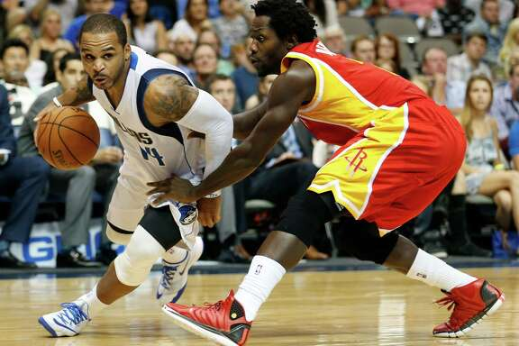Rockets guard Pat Beverley, right, wants to sustain a defensive presence against Mavs guard Jameer Nelson and the like without getting into foul trouble.