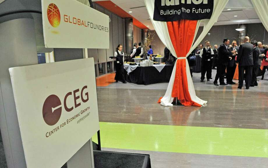 Attendees at the CEG's annual meeting at Fab 8 at GlobalFoundries take part in the reception on Thursday evening, Oct. 23, 2014, in Malta, N.Y.  (Paul Buckowski / Times Union) Photo: Paul Buckowski / 00029180A