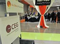 Attendees at the CEG's annual meeting at Fab 8 at GlobalFoundries take part in the reception on Thursday evening, Oct. 23, 2014, in Malta, N.Y.  (Paul Buckowski / Times Union)