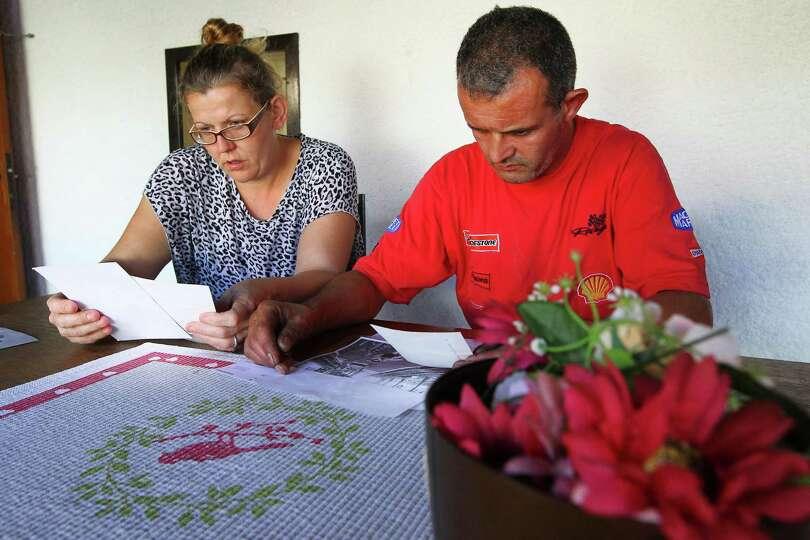 FILE -  In this Thursday, Oct. 2, 2014 file photo, the parents of Sahra Ali Mehenni : Kamel Ali Mehe