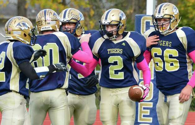 Cohoes' #2 Brandon Laforest is congradulated by teammates after completing a touch down pass during the Class B quarterfinal game against Glens Falls Saturday Oct. 26, 2013, in Cohoes, NY.  (John Carl D'Annibale / Times Union) Photo: John Carl D'Annibale / 00024385A