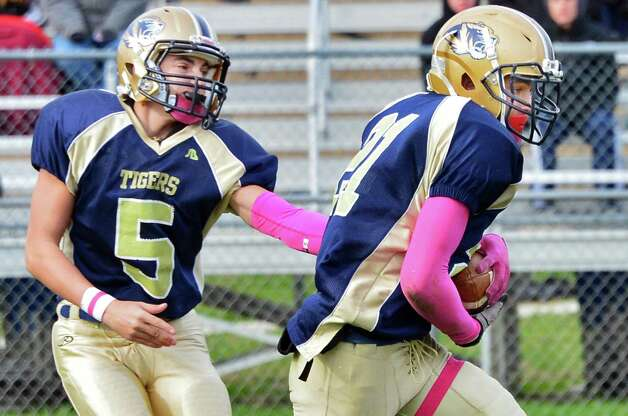 Cohoes' QB #Max Carey, left, hands off to #21 Shelton Alston during the Class B quarterfinal game against Glens Falls Saturday Oct. 26, 2013, in Cohoes, NY.  (John Carl D'Annibale / Times Union) Photo: John Carl D'Annibale / 00024385A