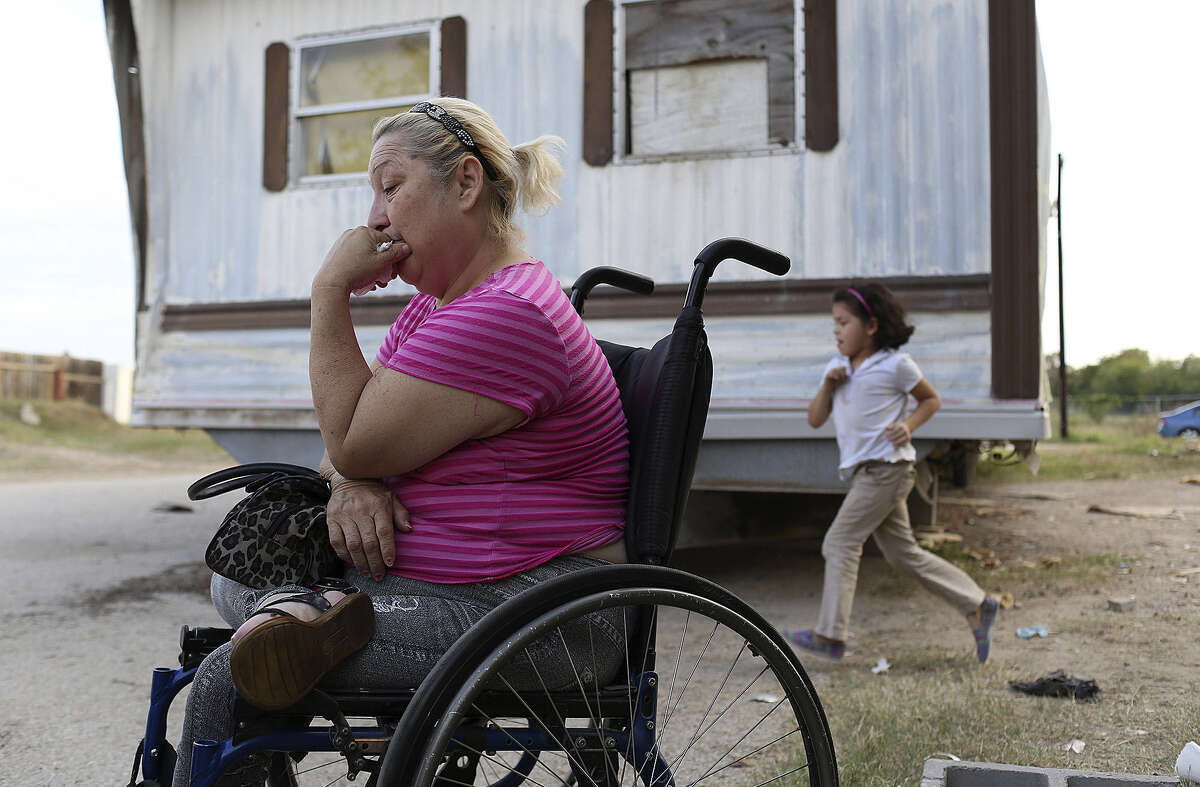 Judy Salazar, paralyzed 26 years ago from a shooting, sits next to her mobile home in Mission Trails Mobile Home Park. The structure of the mobile home began coming apart when it was in the moving process from Mission Trails.