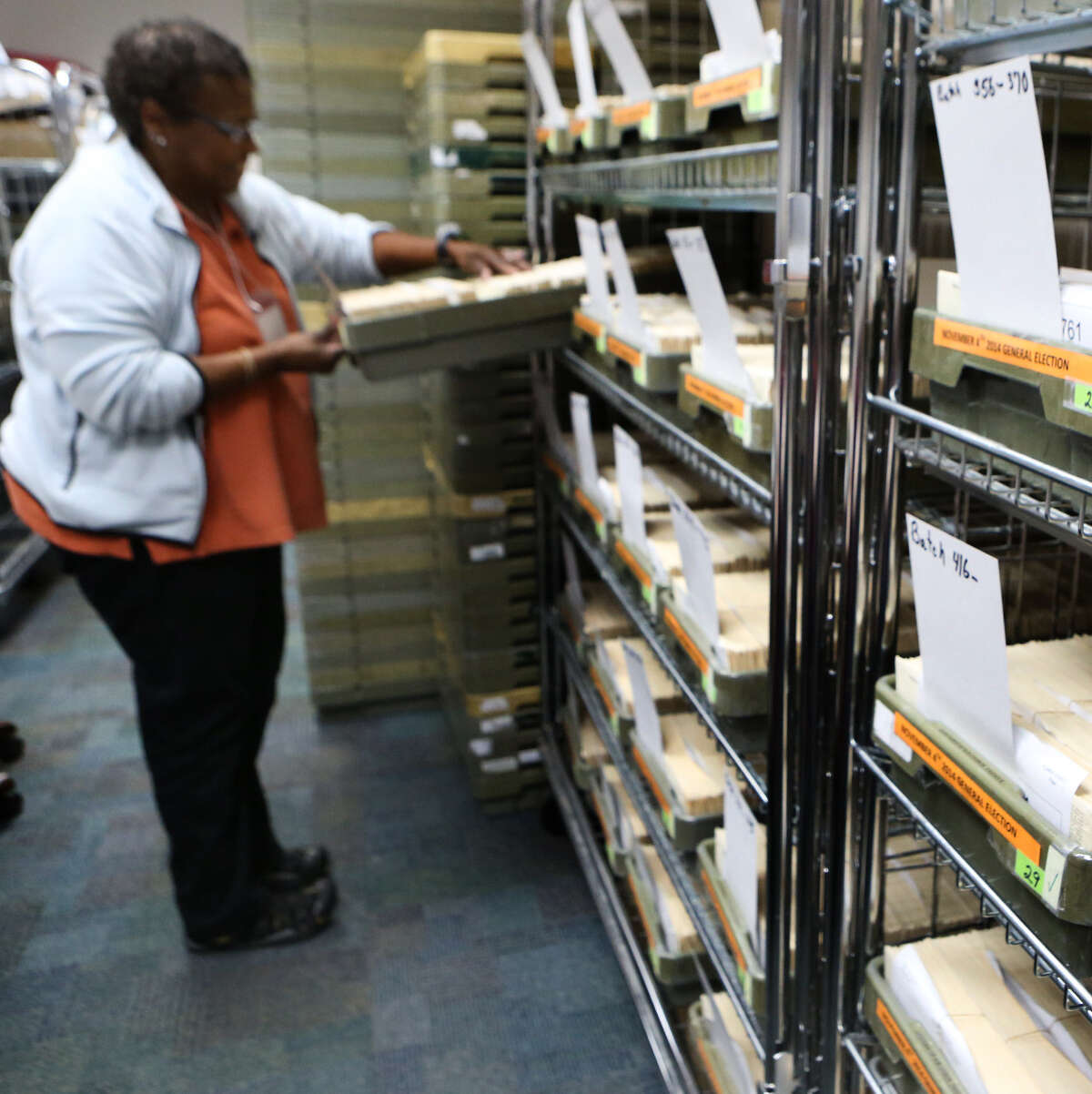 Elections worker Elizabeth Keith goes through a batch of mailed-in ballots.
