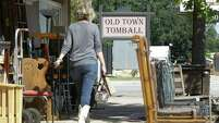 A pedestrian walks along Main St. in Old Main Tomball Thursday, Oct. 23, 2014, in Tomball.  In a special-option election at Tomball City Hall, voters will have a chance to repeal an ordinance preventing Old Town Tomball businesses from selling certain types of alcohol.