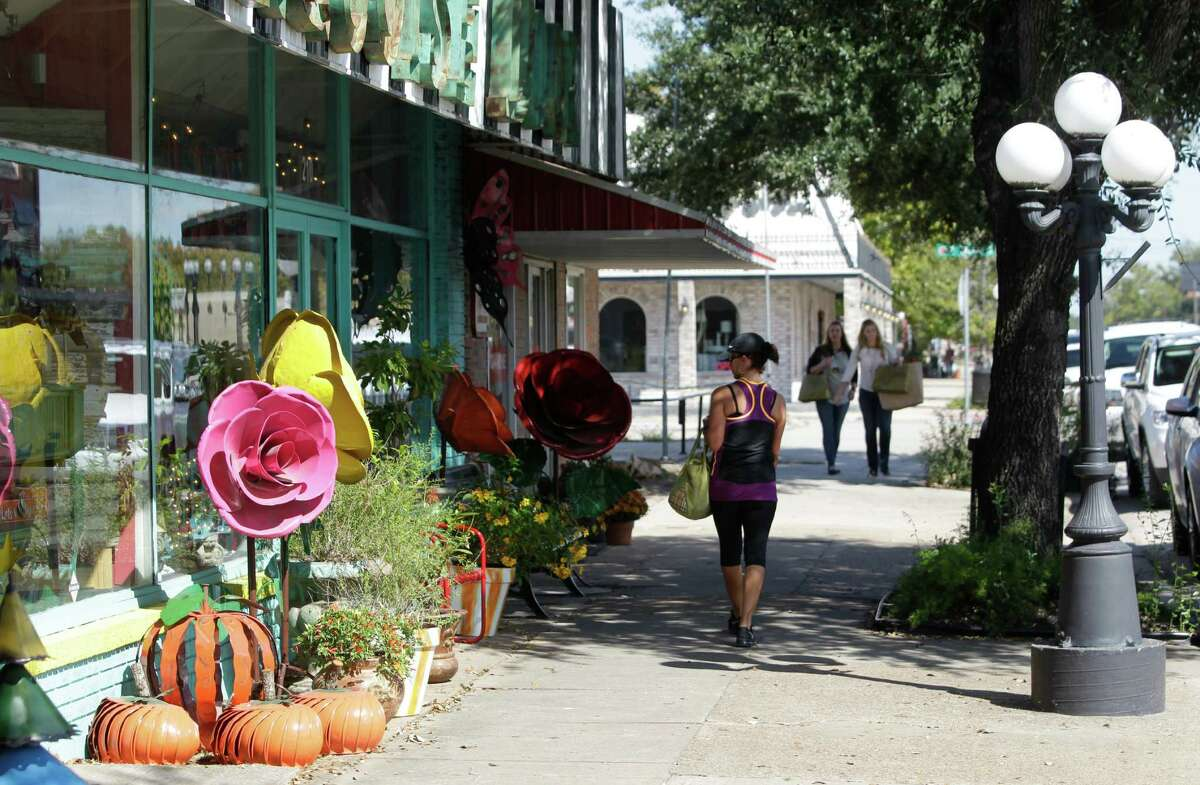 """People walk along Main Street in Old Town Tomball in 2014. The city in northwest Harris County has worked to retain a """"small-town feel."""""""