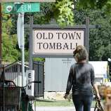 Pedestrians walks along Main St. in Old Main Tomball Thursday, Oct. 23, 2014, in Tomball. In a special-option election at Tomball City Hall, voters will have a chance to repeal an ordinance preventing Old Town Tomball businesses from selling certain types of alcohol.