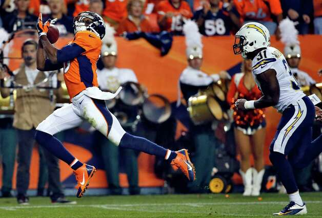 Denver Broncos wide receiver Emmanuel Sanders (10) pulls in a touchdown pass, in front of San Diego Chargers' Richard Marshall during the first half of an NFL football game, Thursday, Oct. 23, 2014, in Denver. (AP Photo/Jack Dempsey) ORG XMIT: COMY125 Photo: Jack Dempsey / FR42408 AP