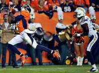 Denver Broncos wide receiver Emmanuel Sanders (10) pulls in a touchdown pass, in front of San Diego Chargers' Richard Marshall during the first half of an NFL football game, Thursday, Oct. 23, 2014, in Denver. (AP Photo/Jack Dempsey) ORG XMIT: COMY125