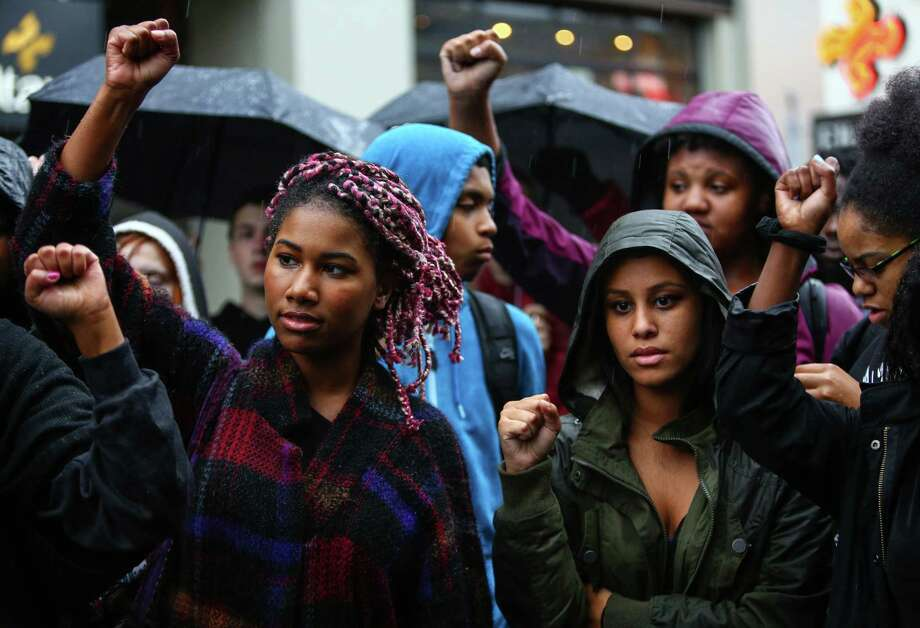 Students affiliated with the Garfield High School Black Student Union gather at the Seattle Police Department's East Precinct after a march there from the school. The young marchers were calling for an end to police brutality. Photographed on Wednesday, October 22, 2014. Photo: JOSHUA TRUJILLO, SEATTLEPI.COM / SEATTLEPI.COM