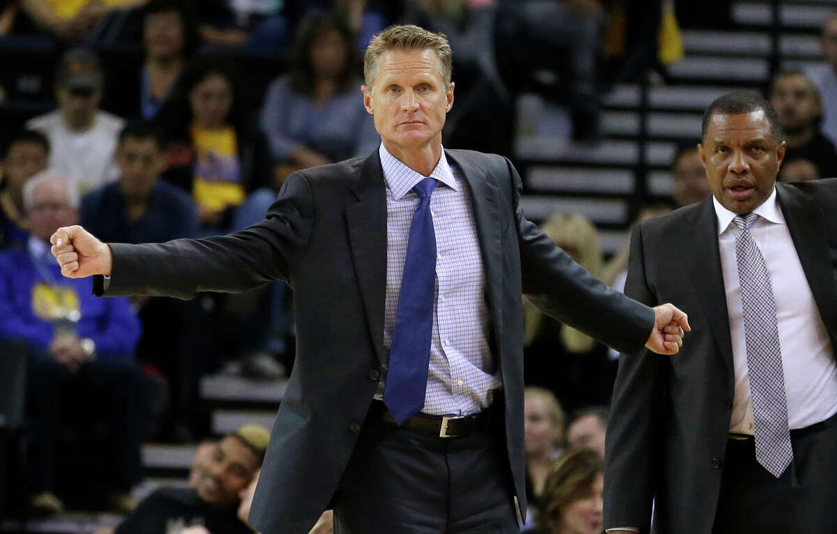 Golden State Warriors coach Steve Kerr, left, gestures from the sideline beside assistant coach Alvin Gentry during the first half of a preseason NBA basketball game against the Los Angeles Clippers on Tuesday, Oct. 21, 2014, in Oakland, Calif. (AP Photo/Ben Margot)