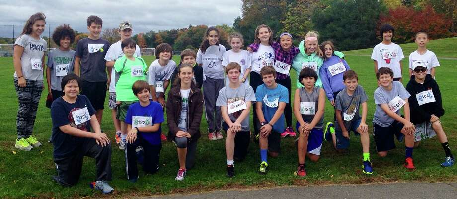"Students from Bedford Middle School recently ran a combined total of nearly 70 miles to support Save the Children's ""Run for Kids"" project. Photo: Contributed Photo / Westport News"