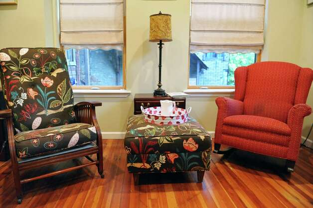 Chairs in the family room in Sandra Rouse's newly purchased home at 159 First Street Tuesday Oct. 21, 2014, in Troy, NY.  (John Carl D'Annibale / Times Union) Photo: John Carl D'Annibale / 00029127A
