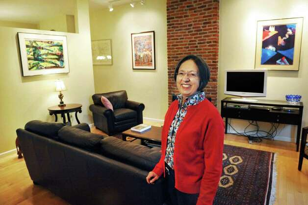Sandra Rouse in the living room of her newly purchased home at 159 First Street Tuesday Oct. 21, 2014, in Troy, NY.  (John Carl D'Annibale / Times Union) Photo: John Carl D'Annibale / 00029127A