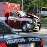 A Houston Fire Department EMS truck and a white SUV were involved in a wreck Friday morning at the corner of Austin and Webster. Airbags deployed on the HFD vehicle, but no one was seriously injured.