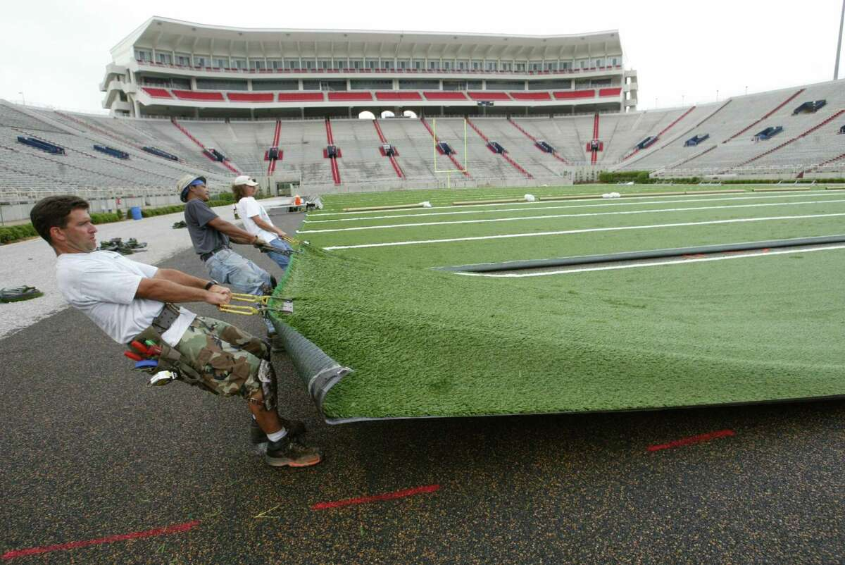 Concerns over the potential of the crumb rubber material used in artificial turf to cause cancer has moved The Woodlands Township to hire a consultant to study the issue and consider alternatives for its Gosling Road Sports Park. Artificial turf is shown being pulled into place in 2003 at the University of Mississippi's Vaught-Hemmingway Stadium in Oxford, Mississippi.