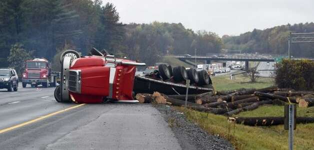 A log truck overturned on the northbound side of the Northway near Exit 13S, causing a massive traffic jam on both sides of the highway. (Skip Dickstein / Times Union)