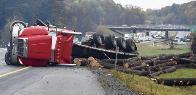 A tractor trailer tipped over on the Northway near Exit 13 in Saratoga Springs Friday morning, causing authorities to close two northbound lanes. (Skip Dickstein / Times Union)