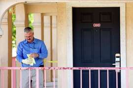 Investigator Rick Guerrero works a scene after a 26-year-old female was stabbed at the Regency Inn and Suites on Friday, Oct. 24, 2014, in Rosenberg .