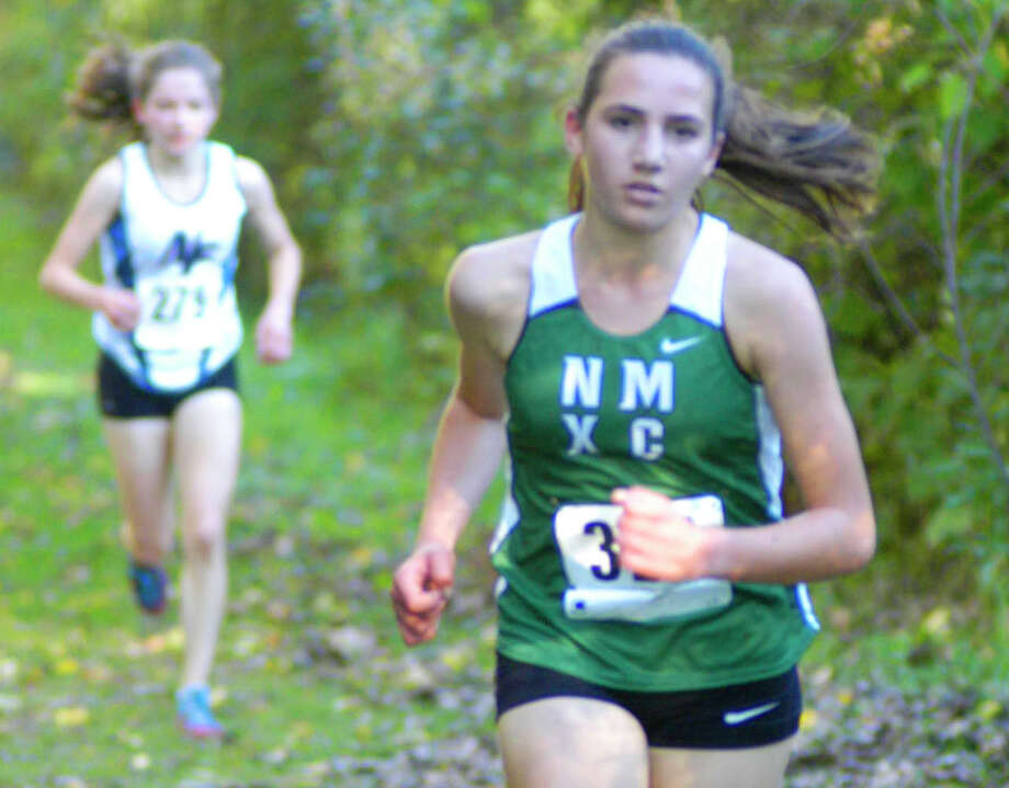 Green Wave sophomore Mia Nahom maintains a 20-yard lead on eventual champion Gabrielle Richichi as they climb The Beast just past midway in the Oct. 17, 2014 South-West Conference girls' cross country race at Bethel High School. Photo: Norm Cummings / The News-Times