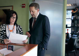 Terri Guess, executive assistant to Giants CEO Larry Baer, confers with her boss at AT&T Park. Guess wasn't a baseball fan when Baer hired her for the job, which is exactly what he was seeking in an assistant.