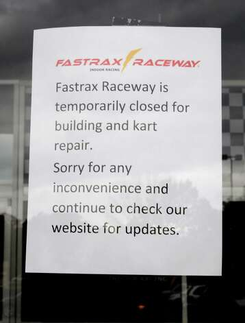 I sign is posted in the door of FastTrax Raceway, an indoor go-cart track at Crossgates Commons in on Friday, Oct. 24, 2014 in Guilderland, N.Y. FastTrax opened in the summer of 2013 and abruptly closed earlier this month, leaving some employees with worthless paychecks and customers unable to redeem gift cards or have event deposits returned, according to an employee. (Lori Van Buren / Times Union) Photo: Lori Van Buren / 00029206A