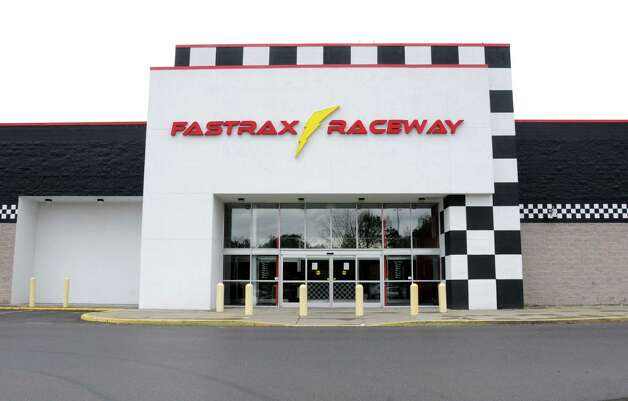 Exterior of FastTrax Raceway, an indoor go-cart track at Crossgates Commons in on Friday, Oct. 24, 2014 in Guilderland, N.Y. FastTrax opened in the summer of 2013 and abruptly closed earlier this month, leaving some employees with worthless paychecks and customers unable to redeem gift cards or have event deposits returned, according to an employee. (Lori Van Buren / Times Union) Photo: Lori Van Buren / 00029206A