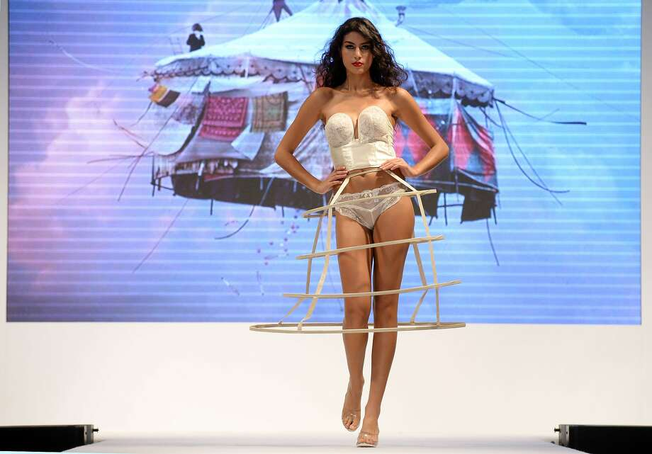 HOOPING IT UP IN SHANGHAI: A lingerie model shows a hoop skirt missing the skirt at the Interfilerie Exhibition during Shanghai Fashion Week. Photo: Johannes Eisele, AFP/Getty Images