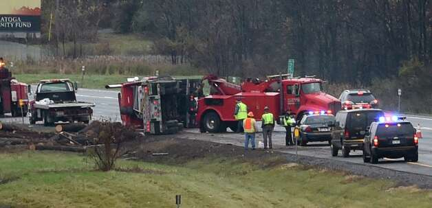 A tractor trailer overturned in the northbound lane of I-87 near Exit 13 Friday afternoon Oct. 24, 2014 in Saratoga Springs, N.Y.    (Skip Dickstein/Times Union) Photo: SKIP DICKSTEIN