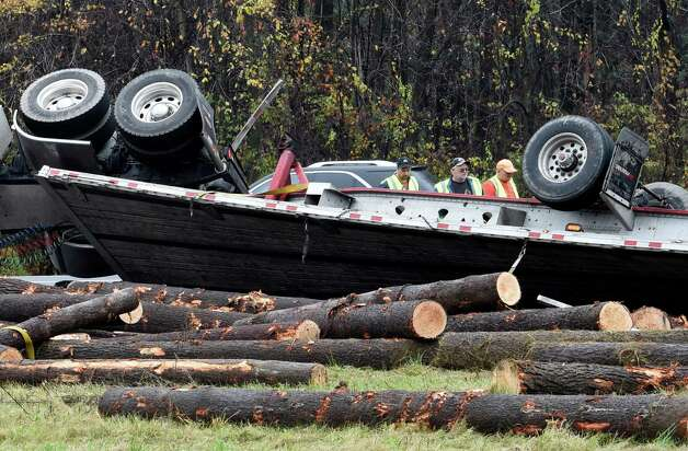 A tractor trailer overturned in the northbound lane of I-87 near Exit 13 Friday afternoon Oct. 24, 2014 in Saratoga Springs, N.Y.    (Skip Dickstein/Times Union Photo: SKIP DICKSTEIN